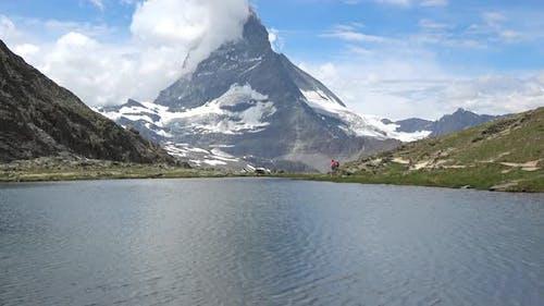 Scenic view on snowy Matterhorn peak and lake Stellisee, Zermatt