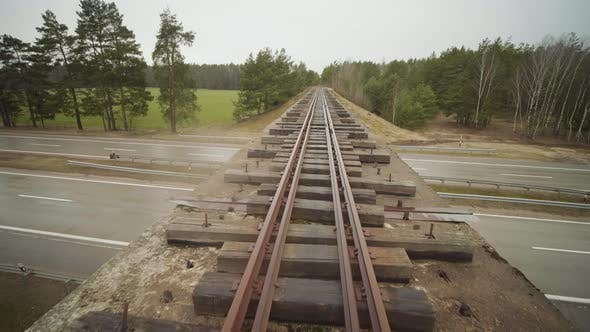 Abandoned Narrow Gauge Railway on the Bridge Over Raod, Autumn Day