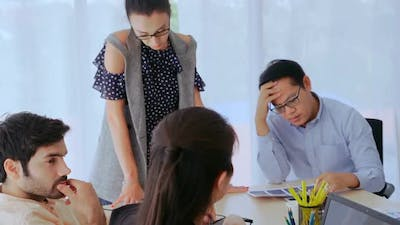 Unhappy Business People in Group Meeting After Project Failure