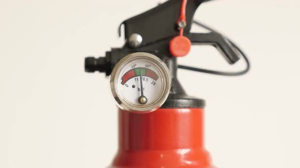 Fire extinguisher with stored-pressure 4K 2160p 30fps UltraHD  tilting  footage - Slow tilt on compa