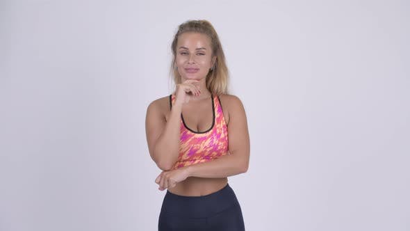 Thumbnail for Happy Young Beautiful Blonde Woman Thinking Ready for Gym