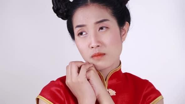 sad asian woman in chinese cheongsam dress