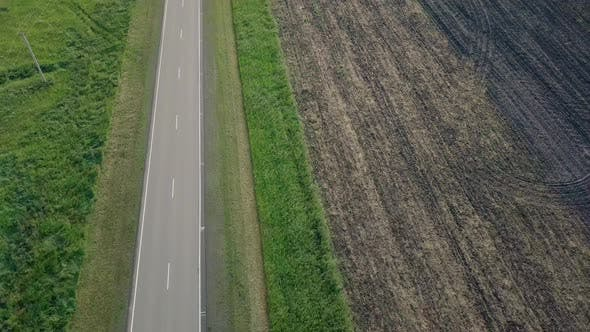 Thumbnail for Aerial Motion Over Ploughed Field Meadow Separated By Road
