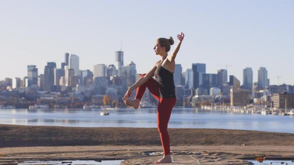 Thumbnail for Fast Motion Series Of Power Stretching Poses By Strong Fit Female Yoga Expert At City Skyline