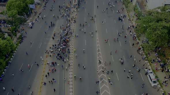 Thumbnail for Aerial view. A crowd attends the car free day along street.