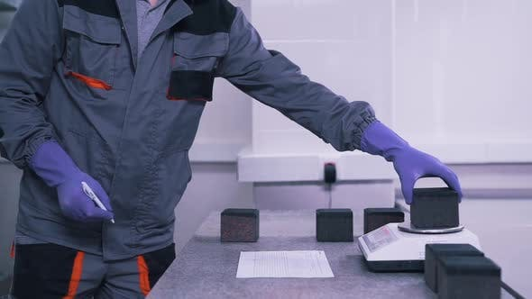 Thumbnail for Man Uses Scales in Lab