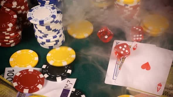 Thumbnail for Gambling Red Dices Poker Cards And Money Chips In Smoke 6