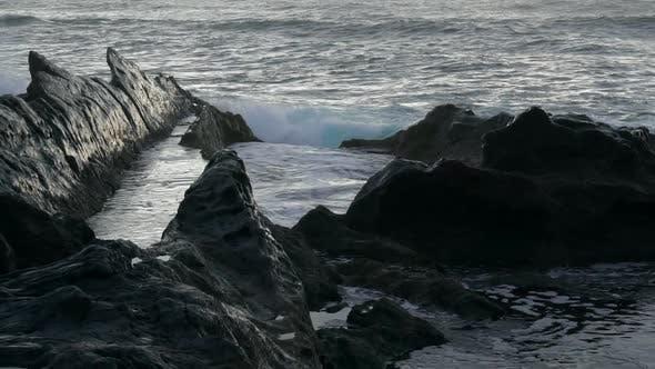 Rocky Black Coast of Volcanic Island