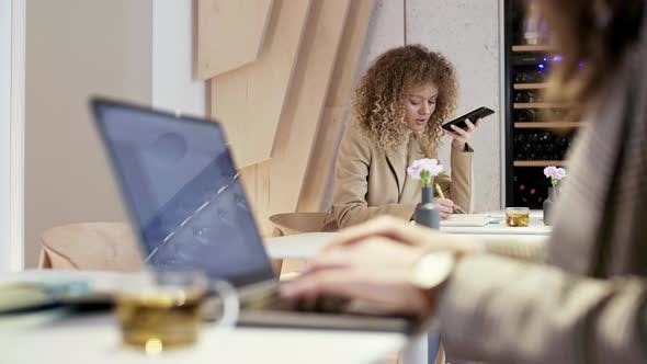 Thumbnail for Pair of Businesswomen Using Devices in Office