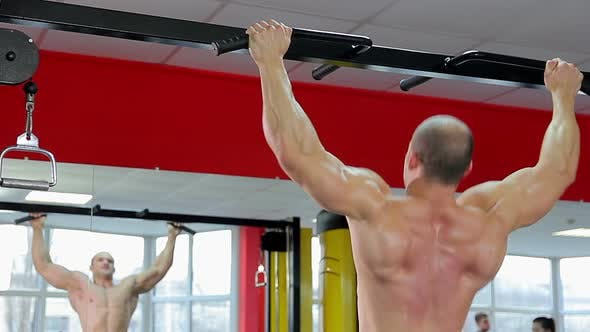 Thumbnail for Muscular Bodybuilder With Strong Body Doing Chin-Up Exercises, Training at Gym