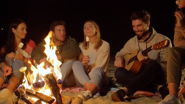 Thumbnail for Friends Roasting Marshmallow and Playing Guitar