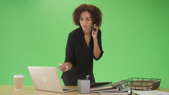 Thumbnail for Millennial african American businesswoman writes notes on green screen