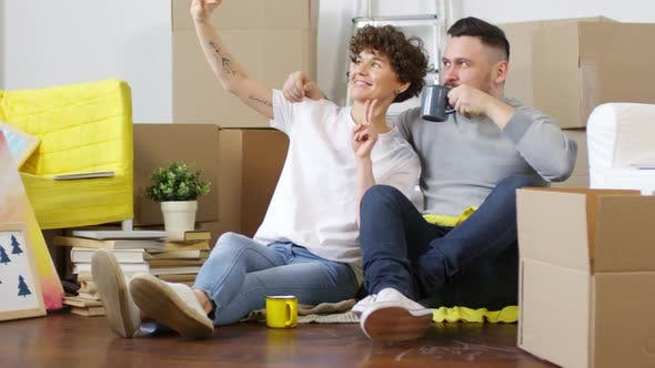 Thumbnail for Delighted Caucasian Couple Taking Selfies in their First Home
