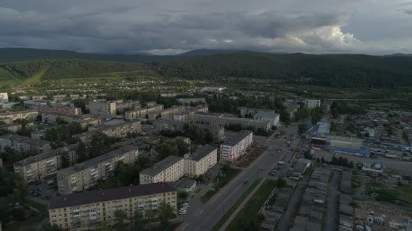 Thumbnail for Aerial view of city with hight and low buildings, Cars are driving, Outside the city Ural mountains