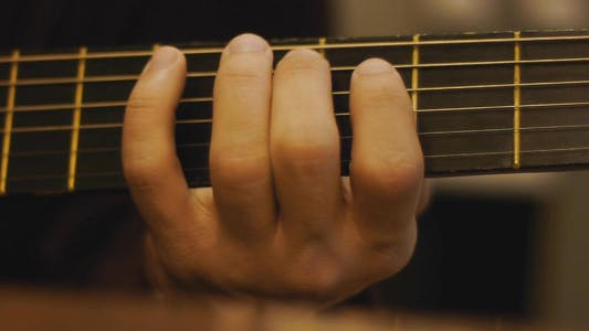 Thumbnail for Man Playing A Guitar