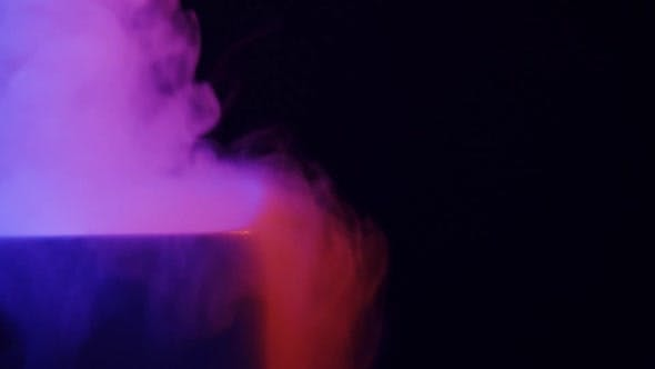 Steam in Colored Lighting on a Black Background