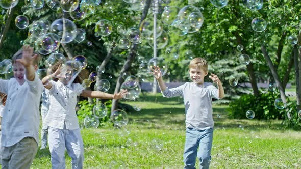Thumbnail for Laughing Kids Catching Soap Bubbles