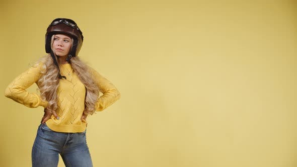 Thumbnail for Woman Modeling with Her Helmet on Her Head While Wind Blowing Her Hair