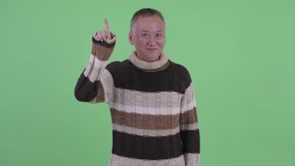 Thumbnail for Happy Mature Japanese Man Pointing Up Ready for Winter