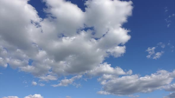 Thumbnail for Time lapse of clouds at blue sky background. Beautiful white clouds in a clean atmosphere