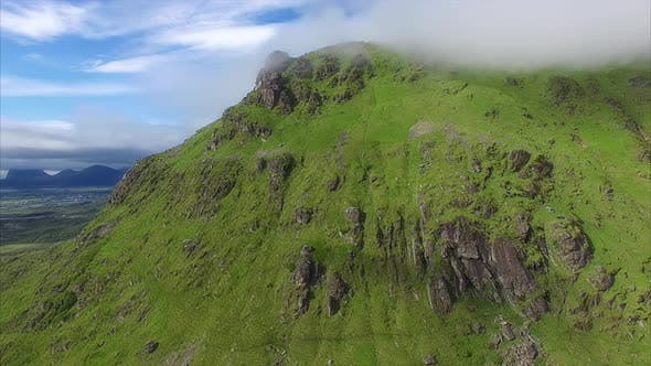 Thumbnail for Grassy mountain slope with herd of sheep, aerial view