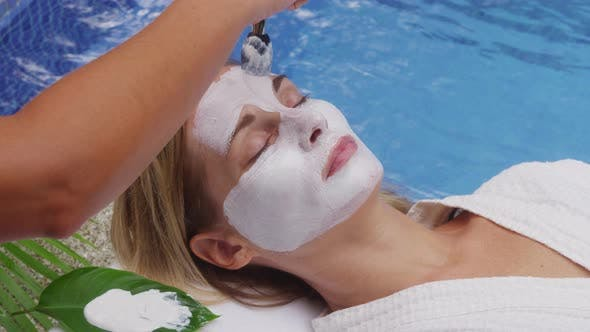 Woman at spa gets facial mask. Shot on RED EPIC for high quality 4K, UHD, Ultra HD resolution.