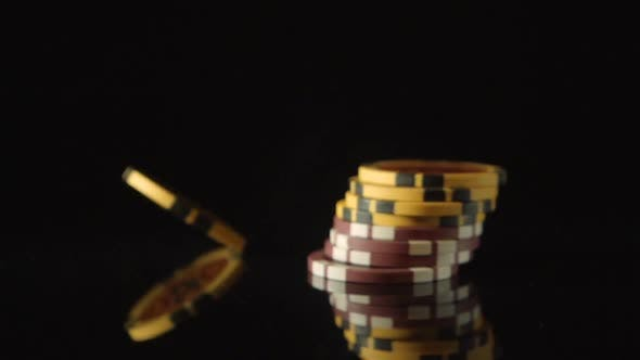 Thumbnail for A playing chips falls on a black desk