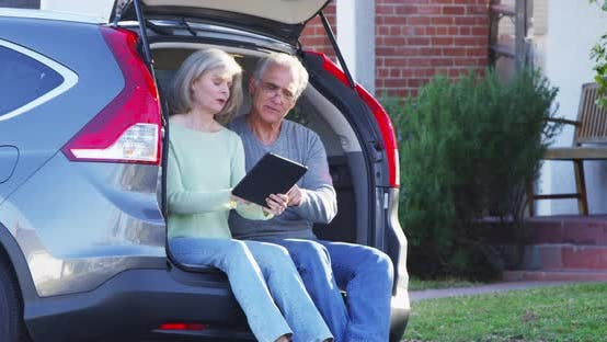 Thumbnail for Senior couple using tablet deciding where to go