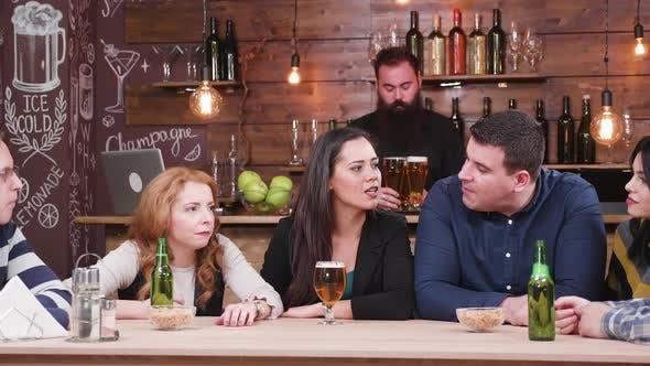Bartender Brings Beer To Customers