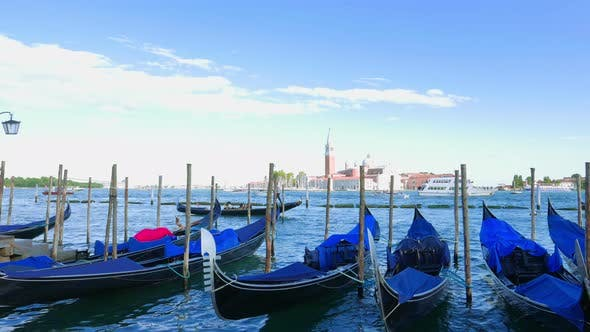 Thumbnail for Parked Gondolas Sway on the Waves in Venice