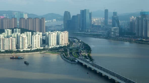 Thumbnail for Macau – Zhuhai Border Earial Cityscape Day Timelapse Pan Up