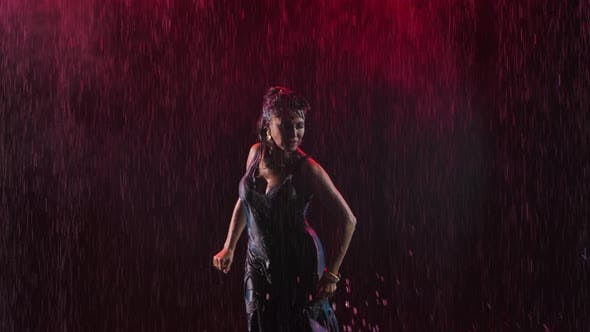 Flamenco. A Passionate Wet Woman Dances a Fiery Spanish Dance in the Rain. Light From Behind. Smoky