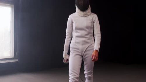 A Young Woman Fencer Walking To the Fighting Area and Starts the Training Duel