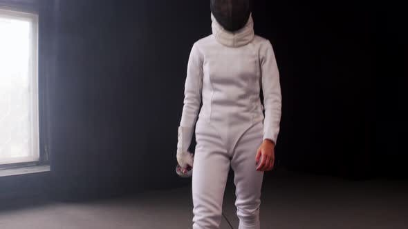 Cover Image for A Young Woman Fencer Walking To the Fighting Area and Starts the Training Duel