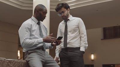 Office Workers Having Conversation