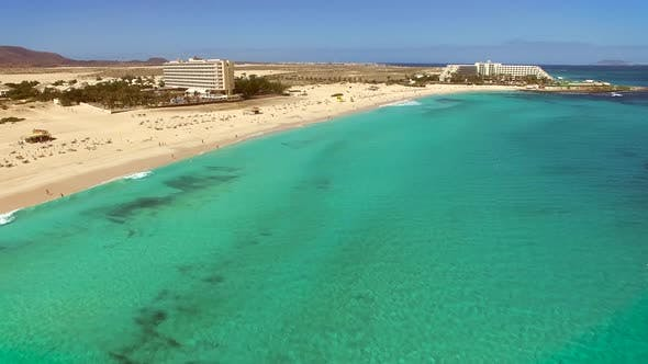 Thumbnail for Aerial view of white sand and turquoise water beach in Fuerteventura.