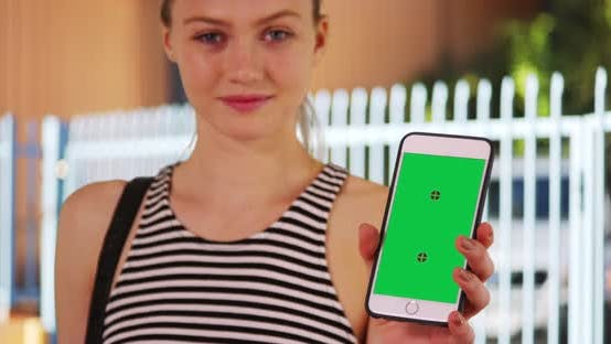 Thumbnail for Single blonde woman showing smartphone with Chroma key