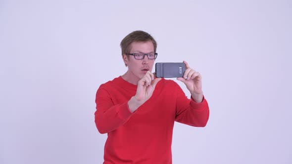 Thumbnail for Happy Young Handsome Man Taking Picture with Phone