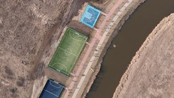 Drone flying over modern sport playground with training area, soccer and basketball fields