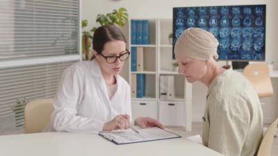 Oncologist Telling Bad News to Female Patient