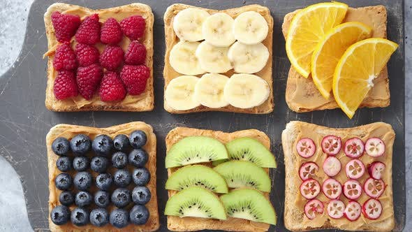 Thumbnail for Wholegrain Bread Slices with Peanut Butter and Various Fruits