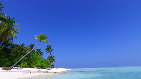 Thumbnail for Luxury birds eye tourism shot of a sandy white paradise beach and aqua blue water background in vibr
