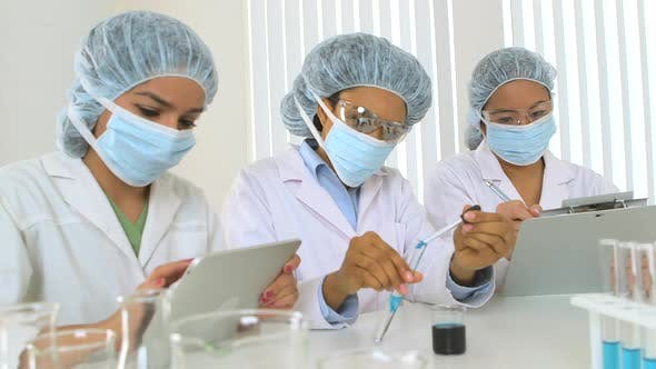 Thumbnail for Three young female scientists at work in the lab