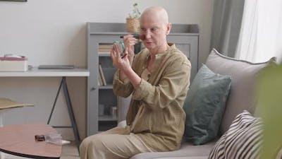 Hairless Woman Applying Make-Up at Home