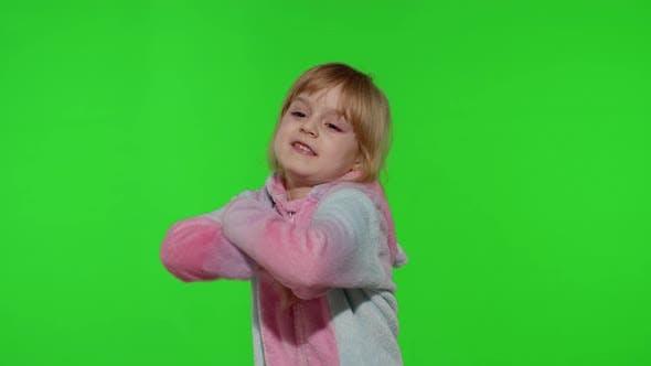 Thumbnail for Little Blonde Child Girl Smiling Dancing Celebrating in Unicorn Pajamas Costume on Chroma Key