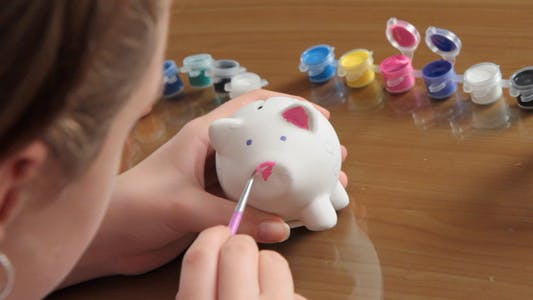 Thumbnail for Girl Decorates The Piggy Bank 2