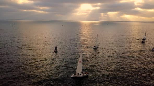 Thumbnail for Aerial view of sailboats floating out to sea