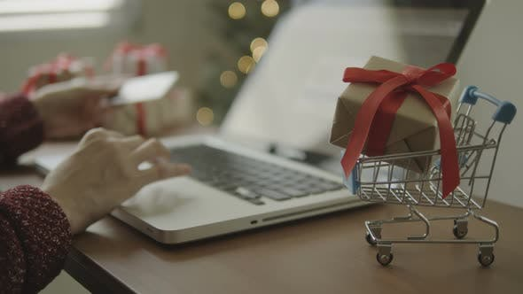 Thumbnail for Christmas Presents On Cart With Blurred Shopping Online