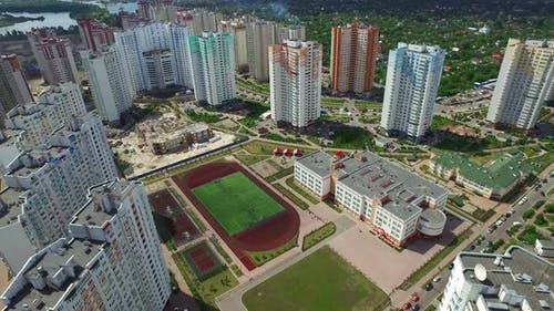 Aerial View Residential High Rise Building and School Sportground in Schoolyard