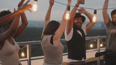 Group of Friends Dancing on Rooftop